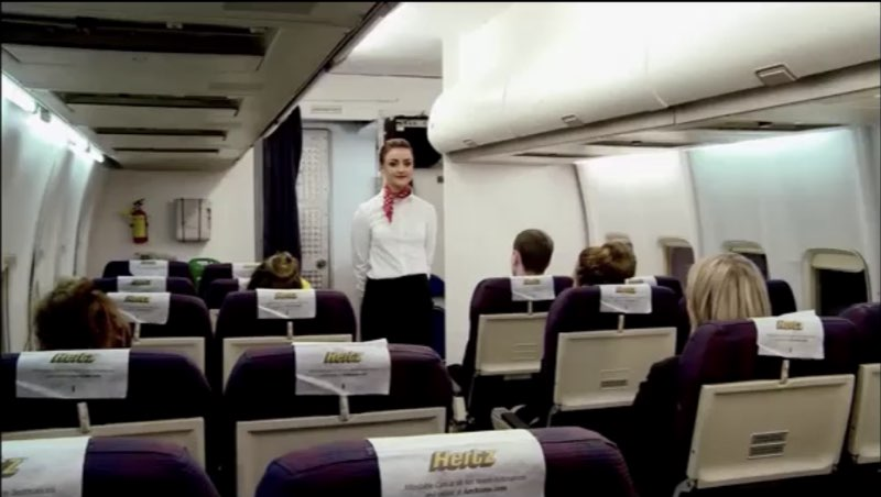Image of a flight attendant about to give a safety demonstration
